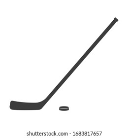 Ice hockey stick and puck icon or black silhouette isolated on white background. Sport equipment symbol.
