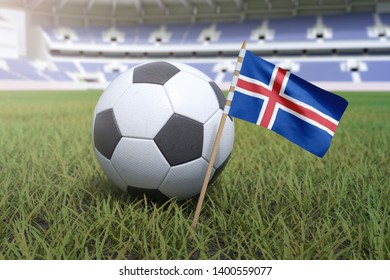 Icelandic flag in stadium field with soccer football