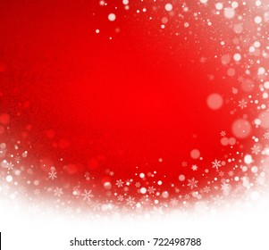 Icy snow wave and snowflakes on a red Christmas background