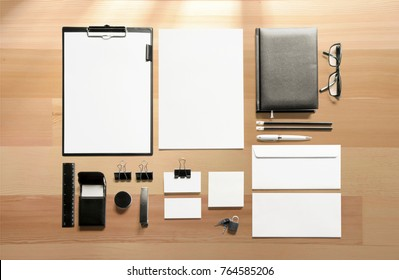 Identity objects set on wooden background to showcase your presentation. Top view 3d render.