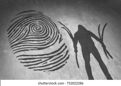 Identity thief and hacker attack internet privacy security technology concept as a criminal stealing parts of a fingerprint.