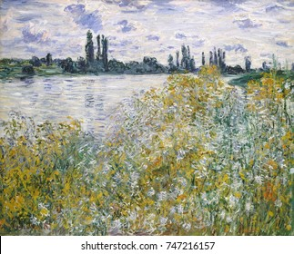 Ile aux Fleurs near Vetheuil, by Claude Monet, 1880, French impressionist painting, oil on canvas. The forms and space of the landscape are dematerialized in the lacework of his brushstrokes