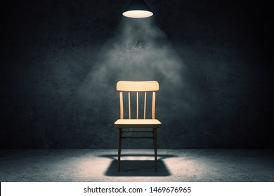 Illuminated chair in dark concrete interior. Furniture concept. 3D Rendering