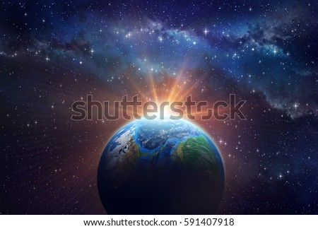 Illuminated face of a planet in outer space, a sunny light shining behind