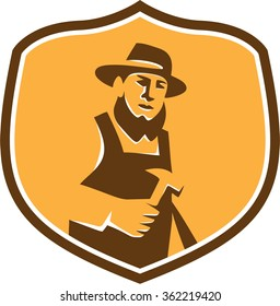 Illustration of an amish carpenter builder wearing hat holding hammer faciing front set inside shield crest on isolated background done in retro style.