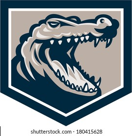 Illustration of an angry alligator crocodile head snout snapping set inside shield done in retro style on isolated background.
