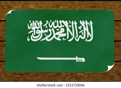 Illustration of an Arabian flag on the paper pasted on the woody wall