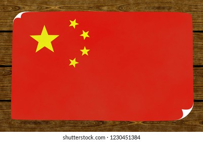 Illustration of a Chinese flag on the papier pasted on the woody wall