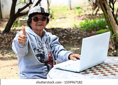 ILLUSTRATION CONCEPT of Trendy Asian Thai Senior learning with computer laptop for technology business working internet shopping  online banking. Happy Education Lifestyle of old woman grandmother.