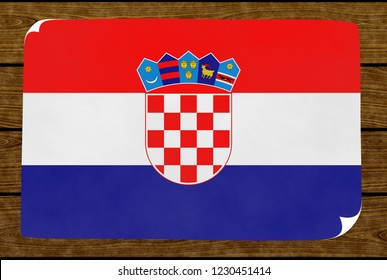 Illustration of a Croatian flag painted on the papier pasted on the woody wall