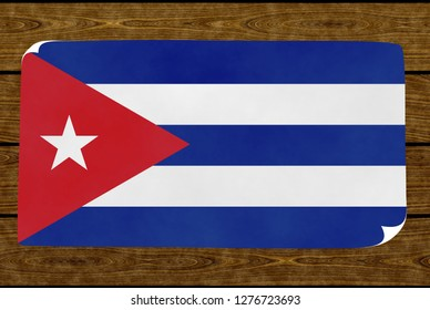 Illustration of a Cuban flag painted on the papier pasted on the woody wall