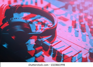 Illustration of DJ headphones edited with 3d stereo effect.Professional disc jockey headset with neon blue & magenta anaglyph filter.Play and listen to the music with headphone equipment on stage