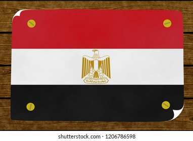 Illustration of an Egyptian flag on the papier pasted on the woody wall