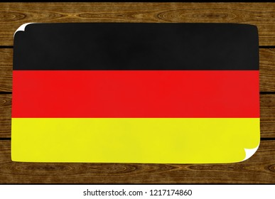 Illustration of a German flag painted on the papier pasted on the woody wall