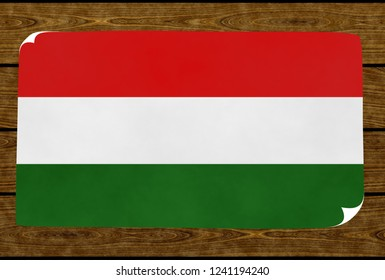 Illustration of a Hungarian flag painted on the papier pasted on the woody wall