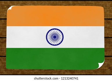 Illustration of an Indiian flag painted on the papier pasted on the woody wall