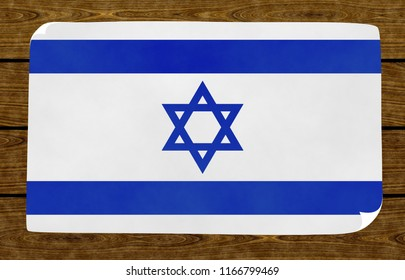Illustration of an Israeli flag on the papier pasted on the woody wall