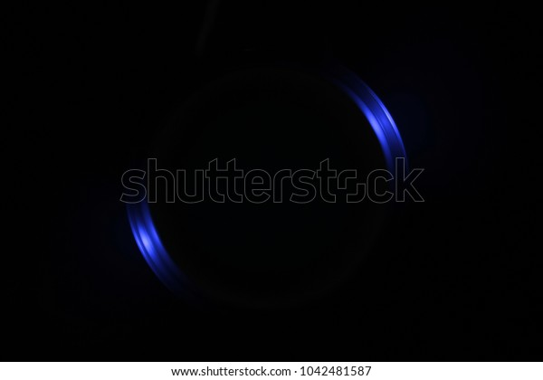 Illustration. Light blue blurred rays. Glare against a black background. Designer background for artistic ideas.