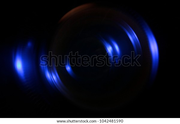 Illustration. Light blue blurred rays. Glare against a black background. Designer background for artistic ideas.