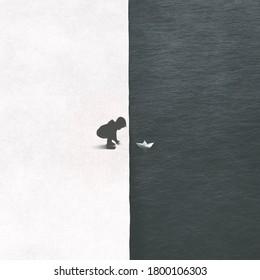 Abbildung eines kleinen Kindes mit Papierboot im Wasser, Kontrastkonzept in Schwarz-Weiß