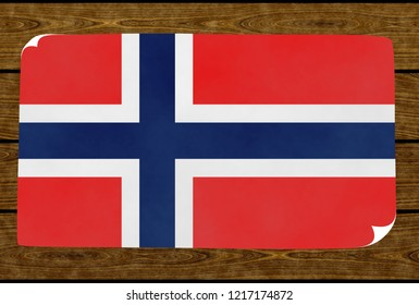 Illustration of a Norwegian flag painted on the papier pasted on the woody wall