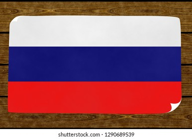 Illustration of a Rusian flag on the paper pasted on the woody wall