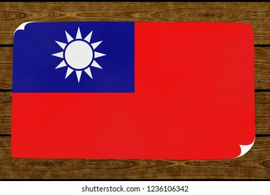 Illustration of a Taiwanese flag on the paper pasted on the woody wall