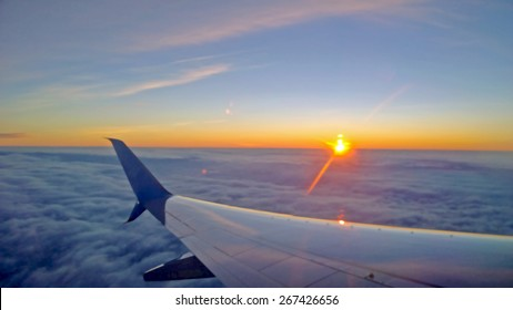 Illustration of View out of a plane window looking across the wing