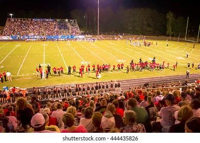 Illustrative image of high school Saturday night football game.