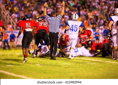 Illustrative image of touchdown at high school football game.