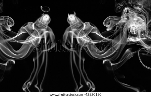 image of an angel and a devil is an abstraction of smoke elements. Good and bad. Antipodes. black and white