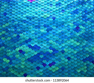 Image closeup of a metal fish scale design in shades of blue and aqua