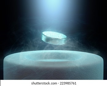 Image concept of magnetic levitating above a high-temperature superconductor, cooled with liquid nitrogen.