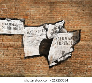 Image of newspapers on a brick wall with graffiti