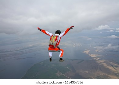Image. Picture of a flying man. Skydiver hovers in the wind tunnel. Extreme hobby without age restrictions.