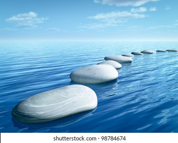 An image of some step stones in the blue sea