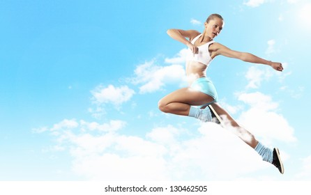 Image of sport girl in jump against cloudy background