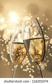 An image of two Champagne glasses on light bokeh background