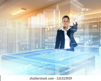 Image of young businesswoman clicking icon on high-tech picture