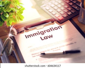 Immigration Law - Text on Clipboard. 3d.