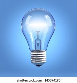 Incandescent light bulb on blue background