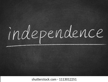 independence concept word on a blackboard background
