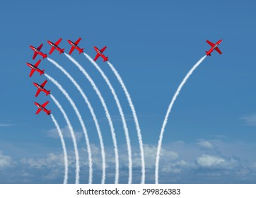 Independent innovation and new thinking concept or individuality leadership symbol as a group of flying jet airplanes with one individual aircraft going in the opposite direction as a business icon.