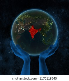 India on night Earth in hands in space. 3D illustration.