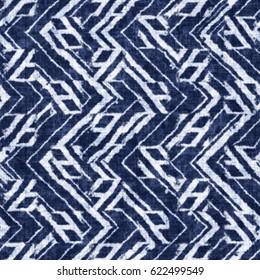 Indigo dyed abstract geometric motif textured background. Seamless pattern.