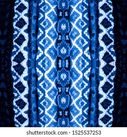 Indigo seamless embroidery pattern. Blue Ikat ethnic ornament. Seamless striped pattern. Geometric in Aztec style. Figure tribal embroidery.Tribal ethnic texture. Arabian,Scandinavian,Mexican,pattern.
