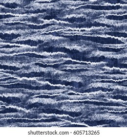 Indigo-dyed effect abstract motif textured background. Seamless pattern.