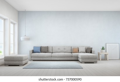 Indoor plant on wooden coffee table and big sofa with empty blue concrete wall background, Relaxing area near window in sea view living room of modern luxury beach house - Home interior 3d rendering