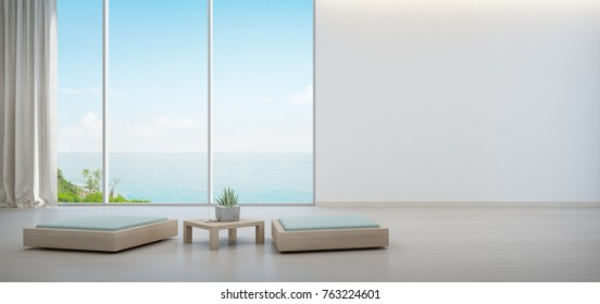 Indoor plant on wooden coffee table and minimal furniture with empty white wall background, Lounge in sea view living room of modern luxury beach house or hotel - Home interior 3d illustration