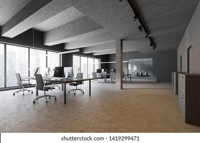 Industrial style open space office interior with gray and wooden walls, concrete floor, panoramic windows, large computer tables and waiting room in background. 3d rendering